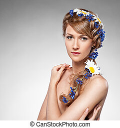 attractive sensual woman with flowers in hair