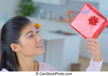 attractive sensual young female with gift box