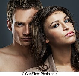 Attractive sexy couple isolated on grey background