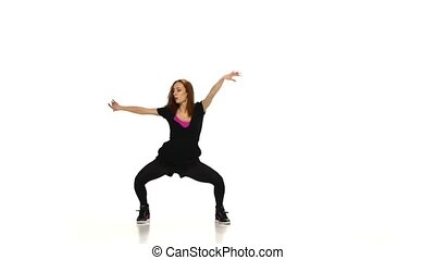 Attractive, sexy, red girl in dark clothes dancing jazz-funk vogueing open class on white background, slow motion