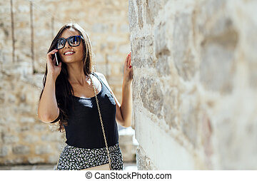 Attractive sexy woman calling on phone