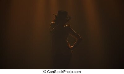 Attractive sexy woman dancing flamenco elements in a dark ...