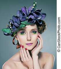 Attractive sexy young woman fashion model in wreath of flowers