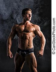 Attractive shirtless muscular man standing in underwear