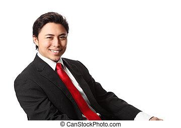 Attractive sitting businessman