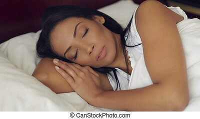 Attractive Sleeping Woman In Bed