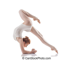 Attractive slim girl doing acrobatic trick, isolated on...