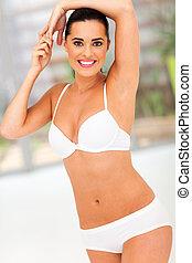 slim woman stretching her arm