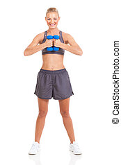 slim woman working out with dumbbells