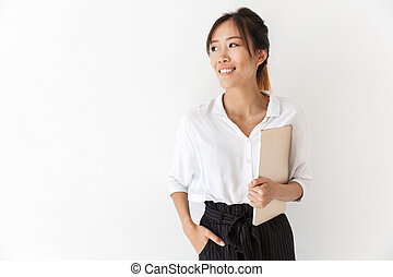 Attractive smiling asian woman standing isolated