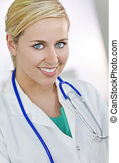 Attractive Smiling Blond Woman Doctor With Stethoscope