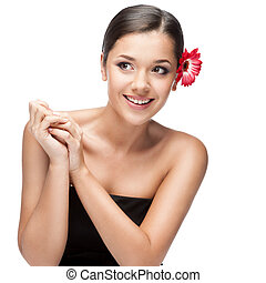 attractive smiling brunette woman with flowers in hair