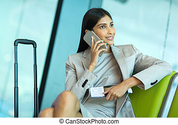 business traveller talking on mobile phone - attractive...