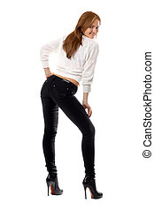 Attractive smiling girl in black tight jeans. Isolated on...