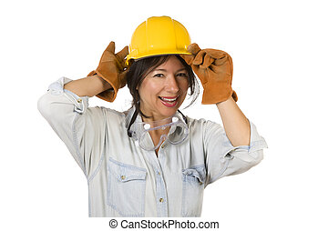 Attractive Smiling Hispanic Woman Wearing Hard Hat, Goggles and Leather Work Gloves Isolated on a White Background.