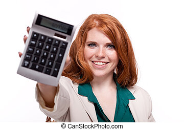 attractive smiling redhead business woman with calculator ...
