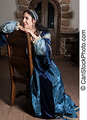 Attractive smiling woman in blue baroque dress