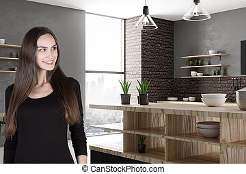Attractive smiling woman in kitchen
