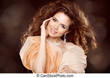 Attractive smiling woman portrait with long curly hair style