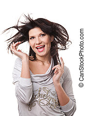 Attractive smiling woman with beautiful windy hair