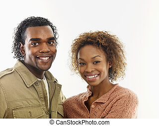Attractive smiling young couple