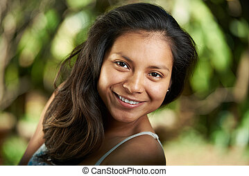 Attractive smiling young hispanic woman