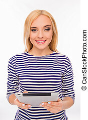 Attractive smiling young woman holding tablet on white background
