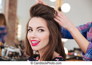 Attractive smiling young woman in beauty salon