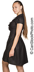 Attractive smiling young woman in black dress