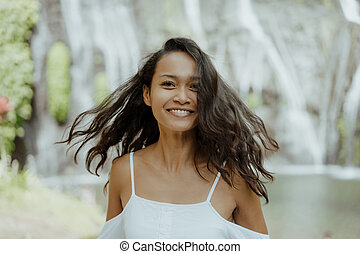 attractive southeast asian woman smiling