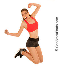 Attractive sporty woman jumps islated over white background