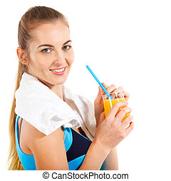 Attractive sporty woman with orange juice