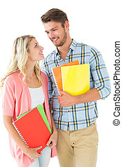 Attractive student couple smiling at each other