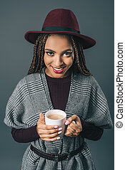 african american girl holding cup