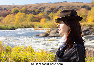 Attractive stylish woman posing in countryside