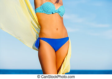 Attractive suntanned female body. - Close up front view of...