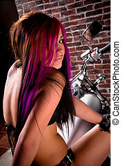 Attractive tattooed girl sitting on a big chopper
