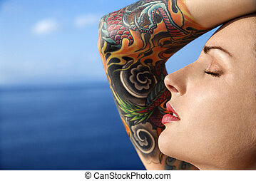 Attractive tattooed woman. - Close up portrait of tattooed...