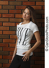 Attractive teen against brick wall