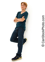 Attractive Teen Boy Leaning Against White Wall
