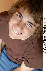 attractive teen boy with brown eyes and big smile