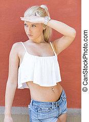 Attractive teen girl posing in the sun