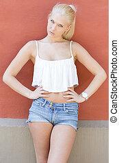 Attractive teen model posing in the sun