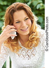 Attractive Teenage Girl Talking On Mobile Phone