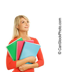 Attractive teenage girl with notebooks isolated on white background