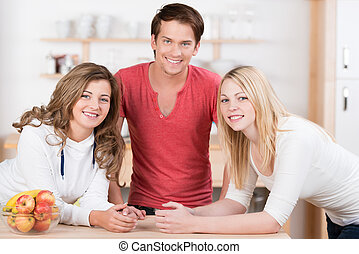 Attractive teenagers relaxing in the kitchen