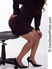 Attractive thirties asian business woman with backpain