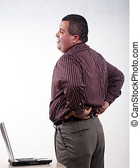 Attractive thirties hispanic businessman having backpain -...