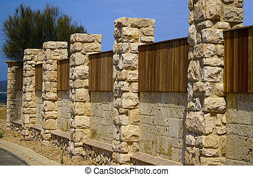 timber and stone fence
