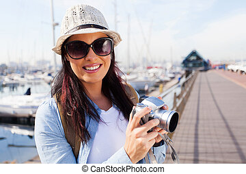 attractive tourist by the harbour